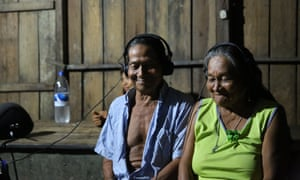 Lourival and Doña Joaquina, Simon McBurney's hosts in Marajaí, listening to the binaural sound recordings.