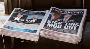 Rupert Murdoch's Sydney Daily Telegraph newspaper (right), alongside the Sydney Morning Herald (left) on 5 August, 2013. The Daily Telegraph urges readers to 'kick this mob out'.