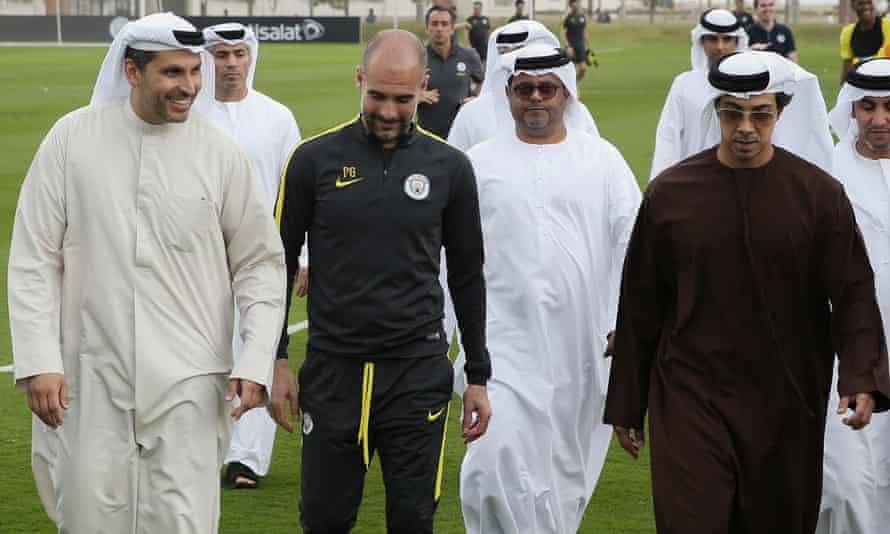 Manchester City's chairman, Khaldoon Al Mubarak (left), and owner, Sheikh Mansour (right), chat with Pep Guardiola in Abu Dhabi