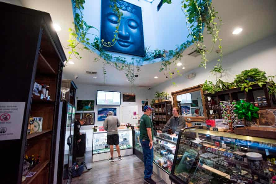 A budtender assists a customer at the Higher Path medical marijuana dispensary in Los Angeles, California.