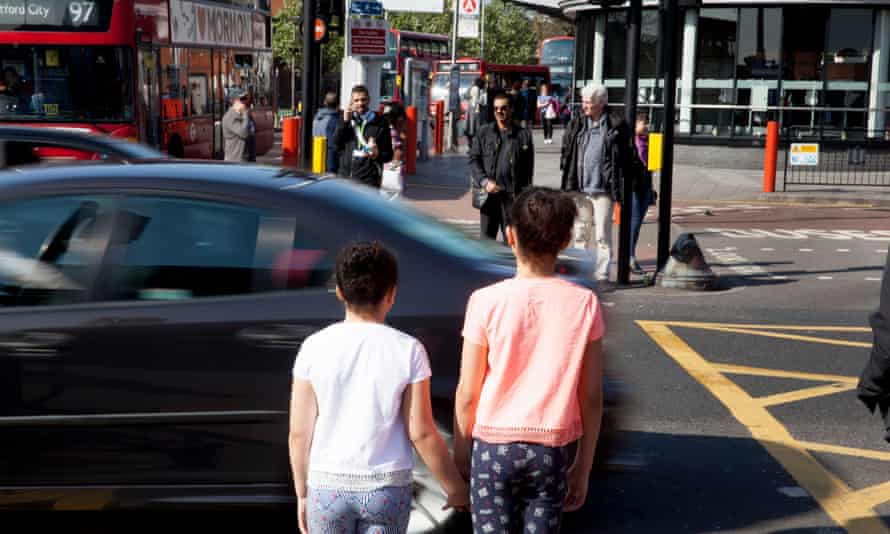 Children stand by a busy London road