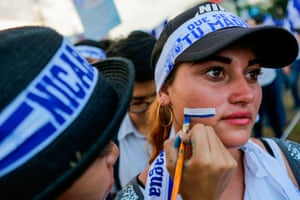 A student gets her face painted in the colours of the Nicaraguan flag during a protest against the government of President Daniel Ortega in Managua in May, 2018