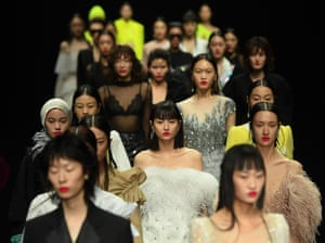 Beijing, ChinaModels walk the runway during the YOUG X collection show by designer Xing Yong on day three of China Fashion Week.