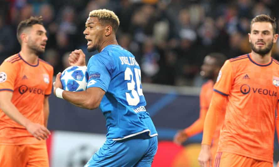 Hoffenheim's Brazilian forward Joelinton celebrates his late equaliser as the Lyon players realised victory has gone.