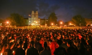 Virginia Tech students pass the flame of a memorial candle on the fifth anniversary of the 2007 shootings on the campus.