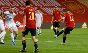 Spain's Dani Olmo fires in the opening goal.