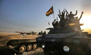 Iraqi forces deploy in al-Shourah, 30 miles south of Mosul, as they advance towards the city.