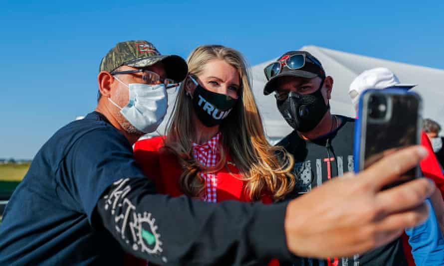 Georgia senator and Trump loyalist Kelly Loeffler takes a selfie with supporters.
