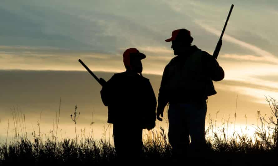 Father and child finish a day of bird hunting.BEHX86 Father and child finish a day of bird hunting.