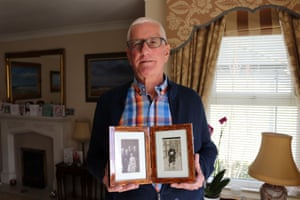 Alan Gaudern with photos of his family