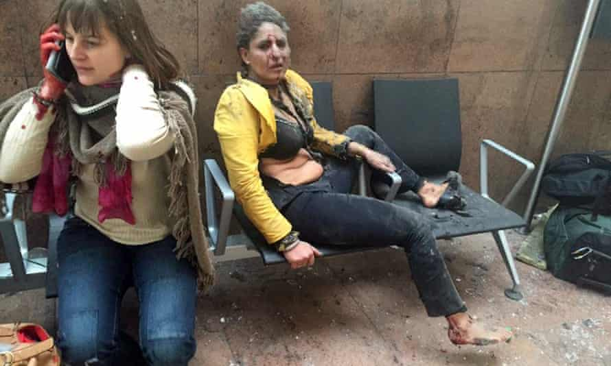 In this photo provided by Georgian Public Broadcaster and photographed by Ketevan Kardava, Nidhi Chaphekar, a 40-year-old Jet Airways flight attendant from Mumbai, right, and another unidentified woman after being wounded in Brussels Airport in Brussels, Belgium, after explosions were heard Tuesday, March 22, 2016. A developing situation left at least one person and possibly more dead in explosions that ripped through the departure hall at Brussels airport Tuesday, police said.
