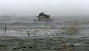 A view of a fisherman's house in the middle of a fish pen as it is pounded by waves, heavy winds and rain brought by Typhoon Rammasun (locally named Glenda) as it hit the coastal town of Bacoor, Cavite southwest of Manila, July 16, 2014. Global warming is causing more extreme precipitation.