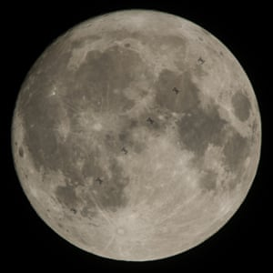 A composite image taken in Pennsylvania, US, shows the International Space Station as it transits the Moon