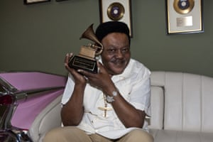 Domino poses after accepting his Grammy lifetime achievement award in 2009