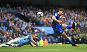 Leicester City's Shinji Okazaki scores their first goal with a fantastic volley.
