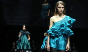 Lace-trimmed shorts, opaque tights and ruffles formed part of the Emporio Armani fall/winter 2020 collection at Milan fashion week