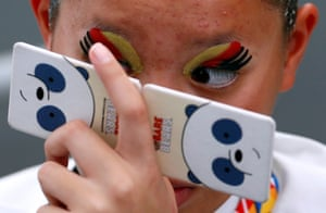 A Thai synchronised swimmer checks her makeup at the Southeast Asian Games in Kuala Lumpur
