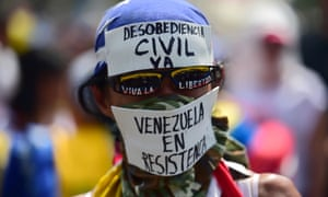 A demonstrator against Nicolas Maduro's government in Caracas on Wednesday.