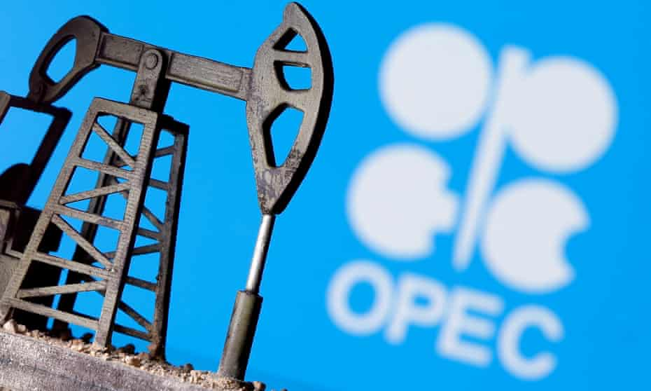 A 3D-printed oil pump jack in front an OPEC logo