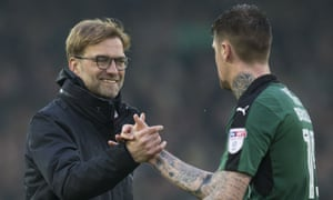 Jürgen Klopp congratulates Plymouth's Sonny Bradley after the goalless draw at Anfield on Sunday.
