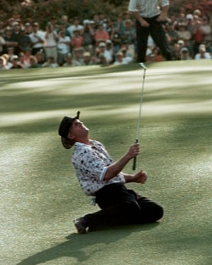 Greg Norman drops to the ground