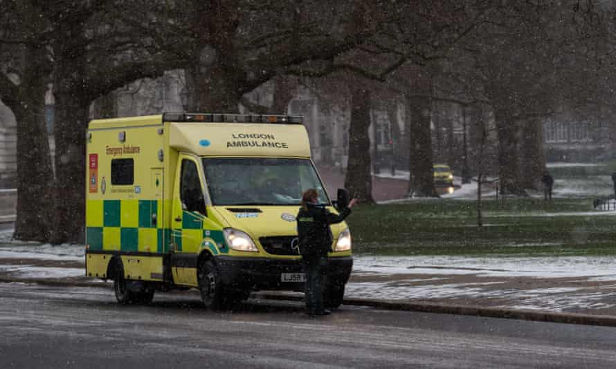 Ambulance staff attend an emergency in snowfall in London – the measures taken to bring down the R number of Sarx-CoV-2 have almost eliminated seasonal flu.