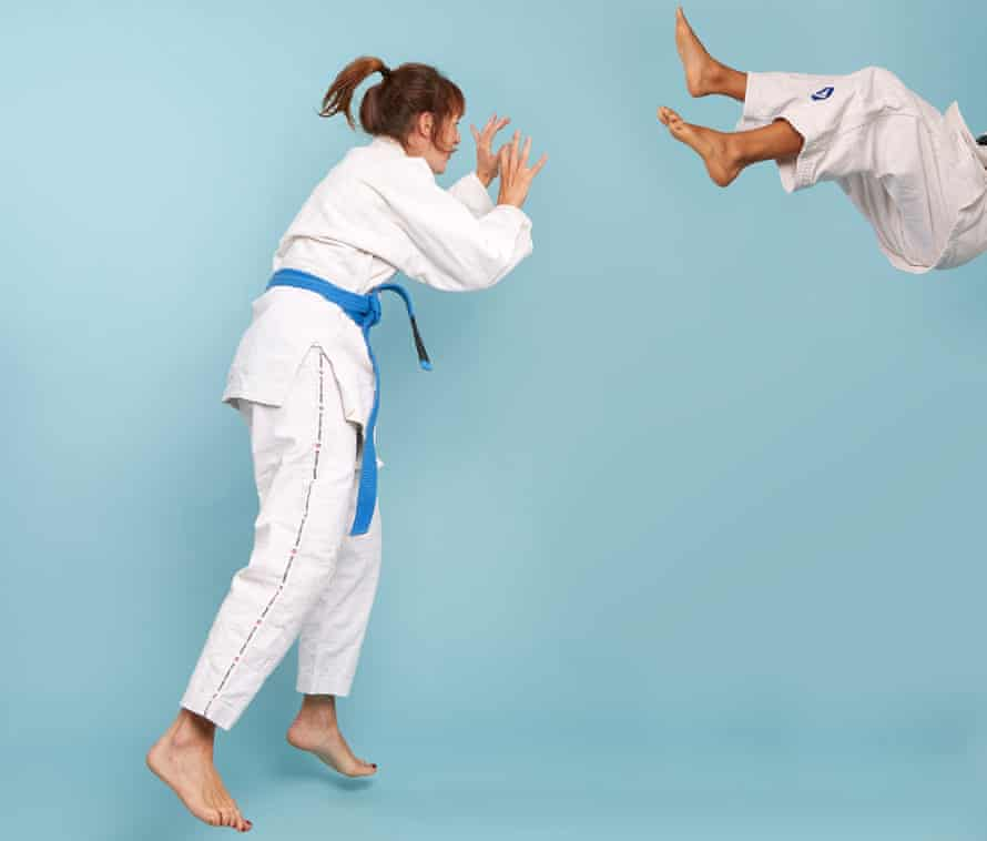 Zoe Williams against blue background, trying Brazilian jiujitsu