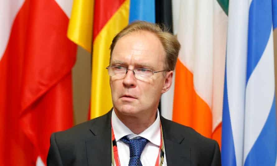 Ivan Rogers stands in front of EU members' flags in 2016