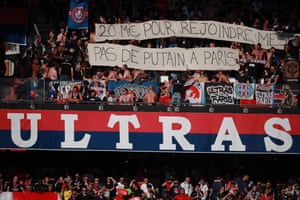 PSG fans at the Parc de Princes hold up a banner that reads: '€20bn to joint Messi. No whores in Paris.'