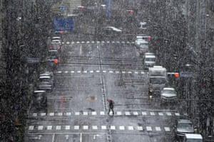 A woman walks in snow