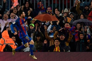 Barcelona's Lionel Messi celebrates in front of the happy Barça fans.