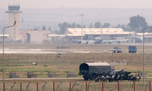 Turkish soldiers position an anti-aircraft gun at Incirlik airbase in the southern city of Adana.