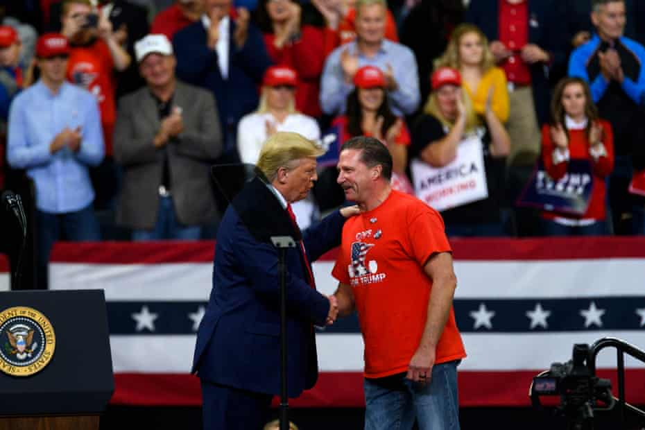 Donald Trump shakes hands with Bob Kroll, head of the Minneapolis police union, during a campaign rally.