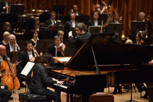Gustavo Dudamel conducting the Los Angeles Philharmonic Orchestra, with soloist Sergio Tiempo at the piano.