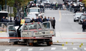 Investigators work at the scene of the' attack where a man driving a truck killed eight people in Manhattan.