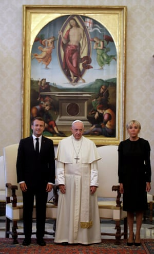 The pope, flanked by the Macrons.