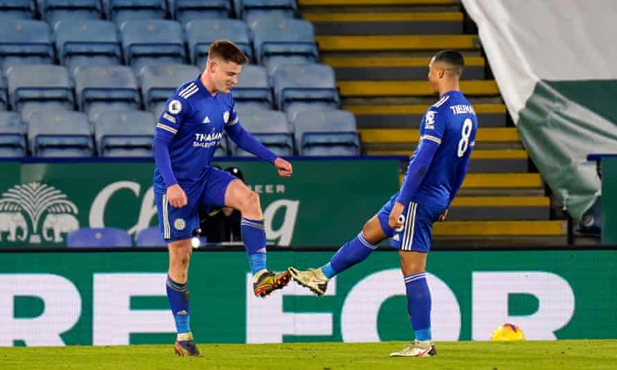 Harvey Barnes of Leicester City celebrates with teammate Youri Tielemans, touching boots to maintain social distancing measures.