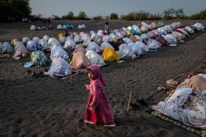 Muslims perform an Eid Al-Fitr prayer in the village of Grogol in Indonesia.
