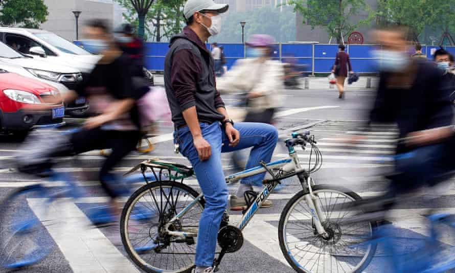 People riding bicycles in Wuhan last month.