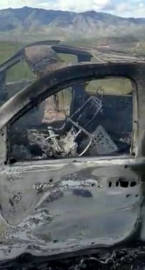 The burnt wreckage of a vehicle in northern Mexico that had been carrying members of the LeBarón family when they were attacked on Monday.