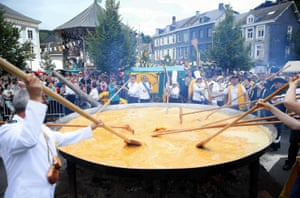 Malmedy, BelgiumMembers of the World Brotherhood of the Huge Omlette cook giant omlette within a 4 metre diameter frying pan