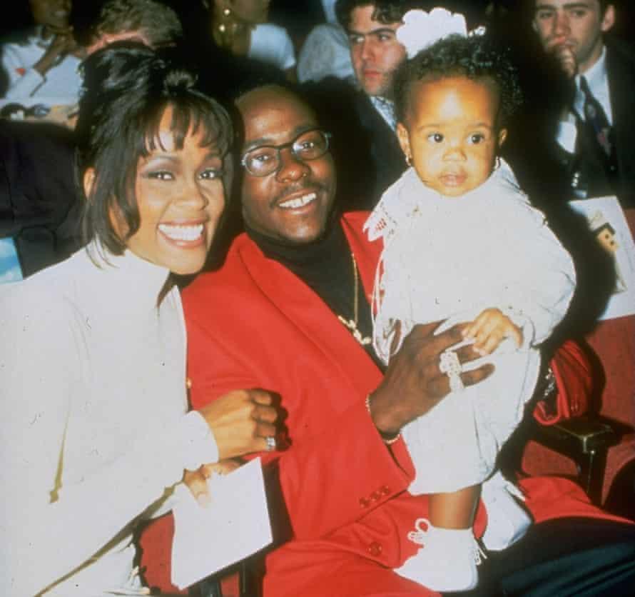 Pop singer Whitney Houston with singer husband Bobby Brown, who is holding their infant daughter Bobbi