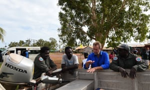 Indigenous affairs minister Nigel Scullion chats with staff of the Crocodile Islands Rangers in the Indigenous community of Milingimbi, Northern Territory, in July 2015.