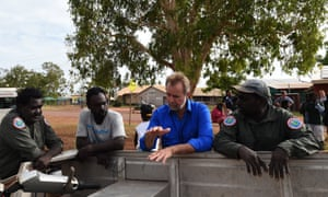 Senator Nigel Scullion with Indigenous rangers at Milingimbi in 2015, launching a local Community Development Program