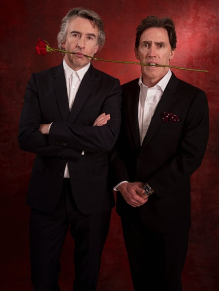 Rob Brydon and Steve Coogan holding a rose between their teeth