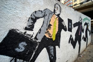 Graffiti with the image of President Michel Temer running with a suitcase of money in central Sao Paulo.