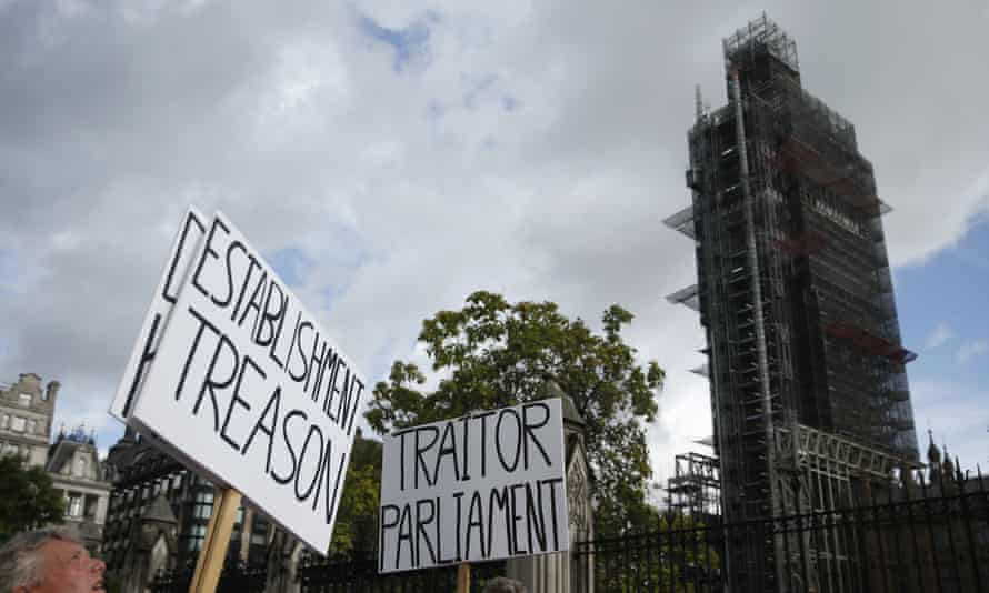 Brexit supporters outside the Houses of Parliament with placards reading 'Establishment treason' and 'Traitor parliament'