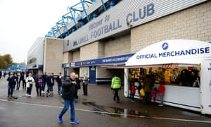 Fans arrive at The Den before the League One game between Millwall and Bristol Rovers earlier this month.