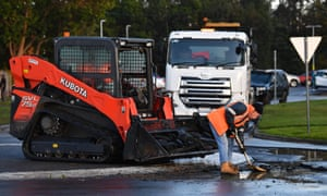 Construction workers assist with the cleanup following heavy flooding in Traralgon