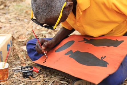 Russell Ashley, an artist from Gapuwiyak on Elcho Island, working on one of his pieces at the 2017 Garma Festival in Northeast Arnhem Land, Northern Territory, Australia. 6 August 2017. By Helen Davidson for The Guardian.